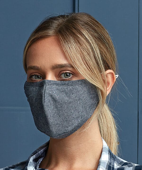 Lady wearing 3 layer fabric mask in denim blue colour way.